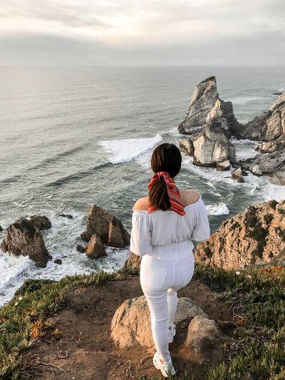 Rear view of woman looking at sea