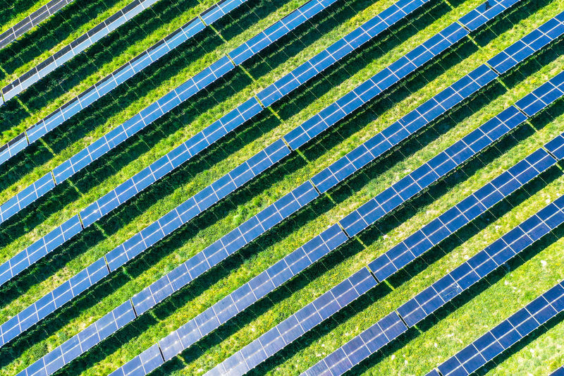 Aerial view of solar panels at a meadow - springtime Aerial View Springtime Spring Landscape Rostock Sun Solar Energy Solar Panel Solar Power Plant Backgrounds Complexity Full Frame Close-up Green Color Shining Streaming Sunbeam Sunrise Countryside
