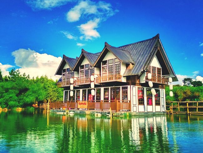 Architecture Building Exterior Stilt House Water House Outdoors Day Sky Tradition Built Structure Cloud - Sky Houseboat Nature Travel Destinations Tree Multi Colored No People Lake Japan Amazing Enjoying Life sunset #sun #clouds #skylovers #sky #nature #beautifulinnature #naturalbeauty photography landscape