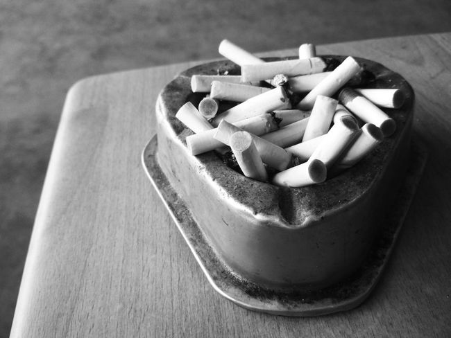 Tobacco Blackandwhite Monochrome Close-up Copy Space Backgrounds Still Life Smoking Smoking Issues Smoking - Activity Smoker Bad Habit Ashtray  Addiction RISK Social Issues Cigarette Butt Danger Ash Full Smoking Issues Smoke Pipe - Smoking Pipe Cigarette Lighter Cigar Cancer - Illness Cigarette  No Smoking Sign Addict Tobacco Product