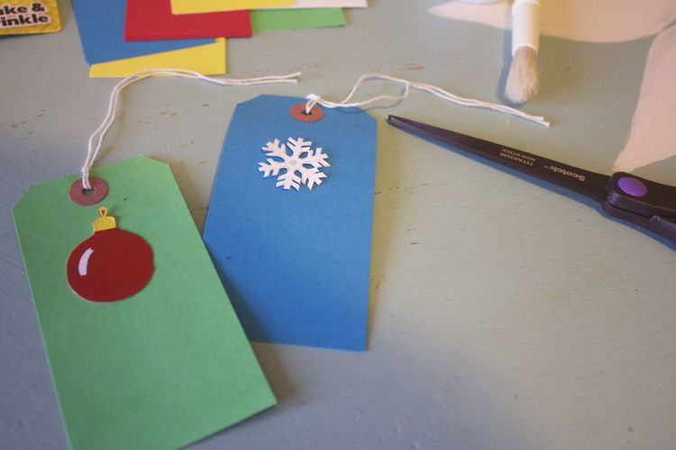 making christmas present tags Christmas Crafts Holiday Gifting Art And Craft Blue Box Close-up Communication Craft Creativity Design Emotion Gift High Angle View Indoors  Multi Colored No People Paper Red Still Life Table Text Western Script
