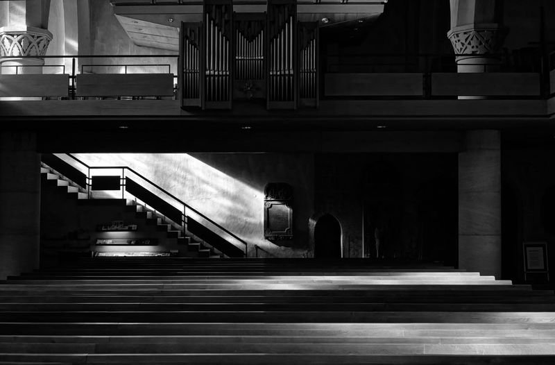 If it's not entirely clear Architecture Staircase Built Structure Steps And Staircases Indoors  Architectural Column No People Railing Building Illuminated Motion Direction City Empty Church Religion Benches