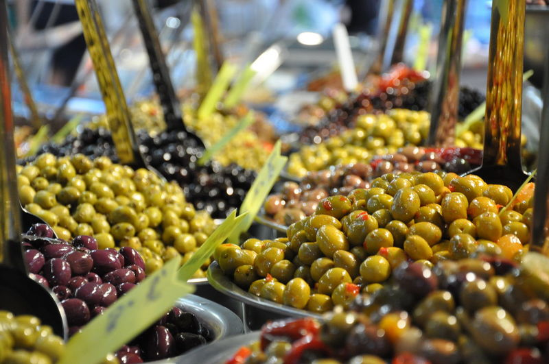High angle view of olives in containers for sale at market