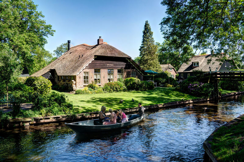 Giethoorn Giethoorn In Holland  Giethoorn The Netherlands Nederland Architecture Beauty In Nature Building Exterior Built Structure Clear Sky Day Holland Holland❤ House Nature Nautical Vessel Outdoors Real People River Sky Tree Water