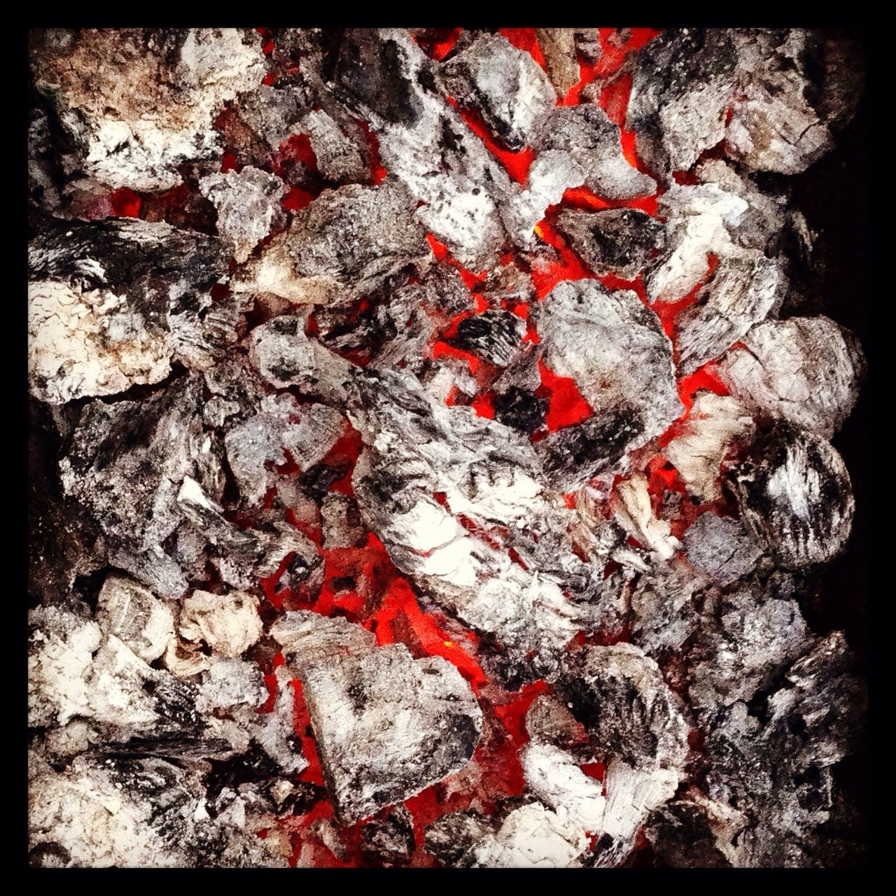 Close-up of red hot charcoal