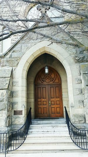 Built Structure Architecture Arch Building Exterior Door Window Entrance Steps Day No People Steps And Staircases Outdoors Architecture Clock Beauty In Nature Freshness Fragility Low Angle View Business Finance And Industry Place Of Worship Cold Temperature Water Real People Medieval Human Hand