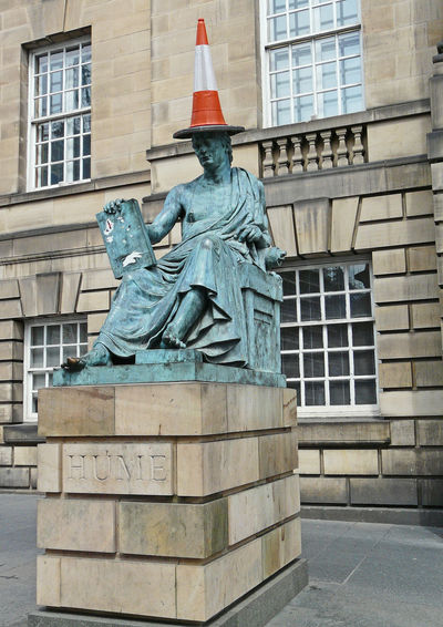 Hume statue after Edinburgh University students played a prank - often happens - Edinburgh, Scotland, UK Architecture City Sky Statue Day History Outdoors Sculpture Cityscape Art And Craft No People Hume Road Cone Travel Destinations Building Exterior Built Structure Human Representation EyeEmNewHere A Taste Of Scotland Edinburgh City Immense Blue Sky University Prank The Graphic City Stories From The City This Is Queer End Plastic Pollution Representation Creativity Male Likeness Memorial Craft The Past Monument Building