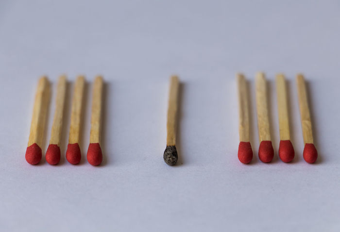 In A Row Order Multi Colored Matchstick Arrangement Red Variation Neat Choice No People Close-up White Background Day Phosphore Red Burned Discrimination Phosphorus Indoors