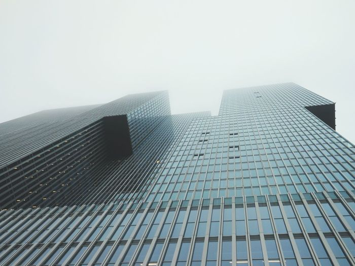 Tall Dutch building in the mist Architecture Skyscraper Building Exterior Tower Tall - High Built Structure Sky City Tall Modern Fog Office Building Architectural Feature Foggy Capital Cities  No People Rotterdam Rotterdam Architecture Rotterdam Skyline Glass Building Business Zakelijk Embrace Urban Life