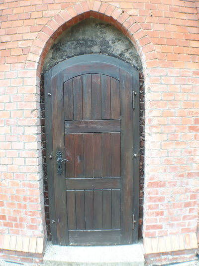 Arch Architecture Brick Wall Building Exterior Built Structure Closed Day Door No People Outdoors Window