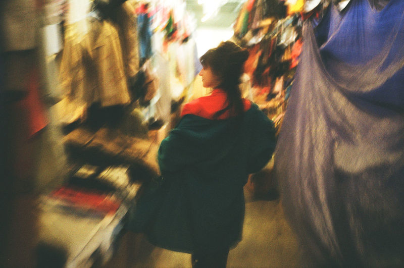 Blurred image of woman walking on street in city