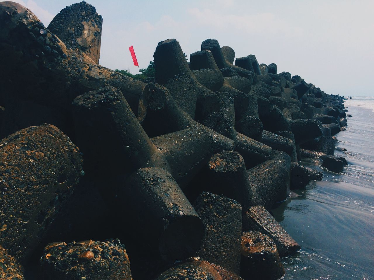 day, outdoors, rock - object, history, sea, no people, flag, patriotism, nature, beach, sky, groyne