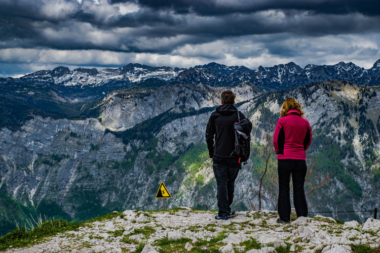 Slovenia Adventure Backpack Beauty In Nature Casual Clothing Cloud - Sky Cloudy Couple Full Length Hiking Landscape Leisure Activity Lifestyles Men Mountain Mountain Range Nature Non-urban Scene Rock - Object Scenics Sky Slovenia Tourist Feel The Journey Tranquility Two