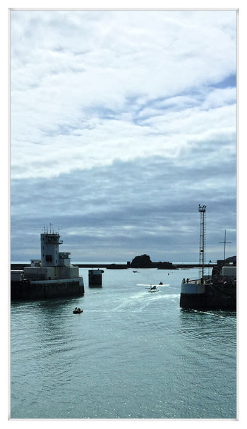 A novel sight, a sea plane makes it's way out of the harbour to take up position at the end of Small Roads, which is to be the runway. All to do with the Jersey Boat show I'm guessing. Blue Calm Cloudy Day Harbour Jersey Novel Portrait Format Sea Plane Serene
