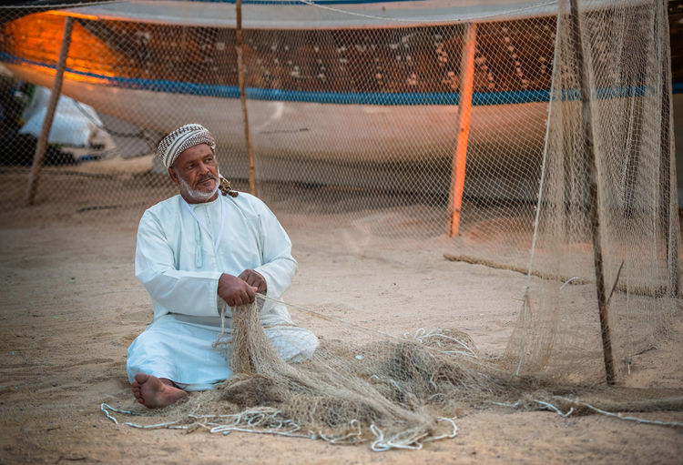 Katara Cultural Village Qatar Doha,Qatar Cultures Culture Hertitage Travel Tourism Arab Gulf Occupation One Person Working Outdoors Livestock Men Handcraft Fishing Industry Fisherman