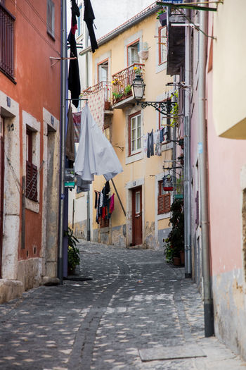 City City Life Colourful Lifestyle Architecture Building Exterior Built Structure City Clothes Clothesline Clothing Day Drying Drying Clothes Empty Empty Road Lifestyles Lisboa Lisbon No People Outdoors Residential Building Street Street Photography Streetphotography