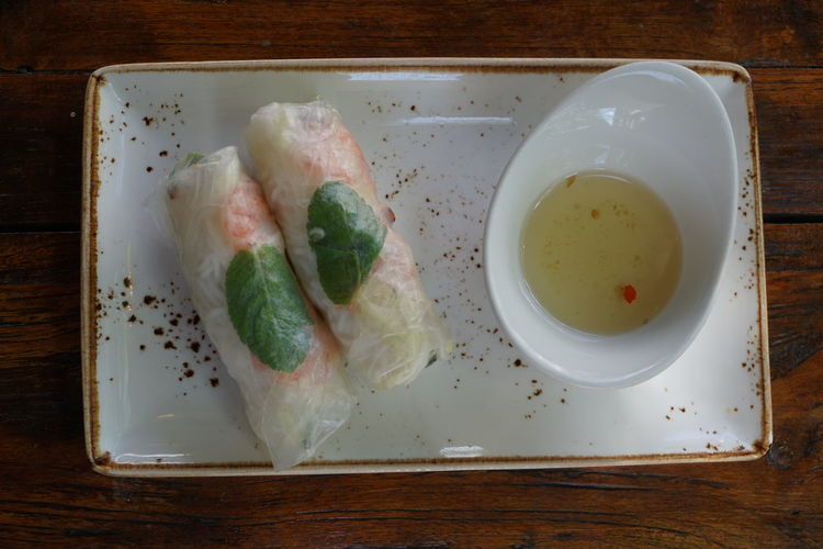 Rice Paper Roll Vietnamese Vietnamese Food Close-up Food Food And Drink Freshness Healthy Eating High Angle View Indoors  No People Plate Ready-to-eat Rice Paper Roll Rice Paper Rolls Still Life Summer Summer Rolls Table Tray Wellbeing Wood - Material