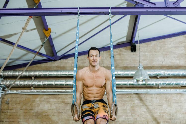 Full length portrait of shirtless man
