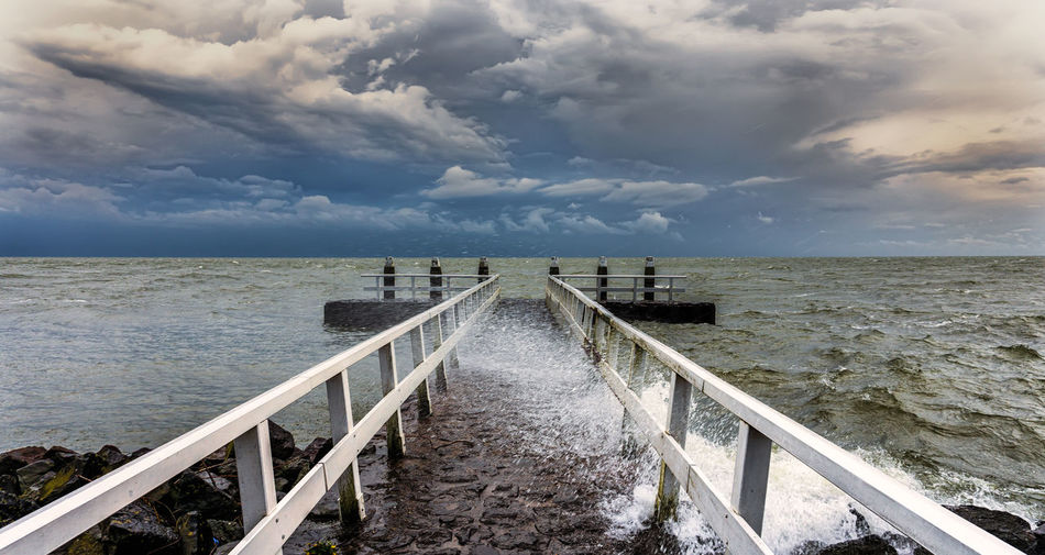 --Weather-- Bridge Clouds Clouds And Sky Diminishing Perspective Ijsselmeer Narrow Outdoors Pier Railing Sky Vanishing Point Water
