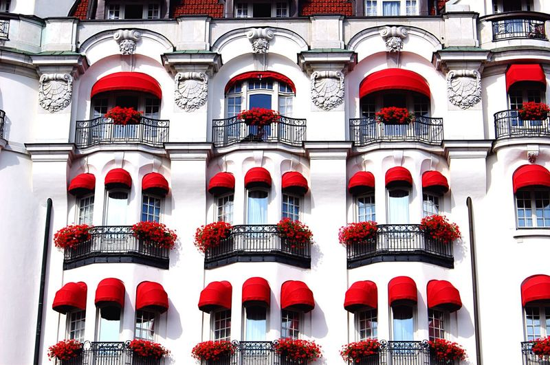 [ Vivid in Stockholm ] Phone call easy peasy on the balcony. Apartment Architecture Awning Balcony Balcony View Blind Bright Building Exterior Built Structure City Daytime Façade Flowers Neighborhood Neighbors On The Phone... Red Roof Swedish Symmetrical Symmetry Vivid VSCO Windows