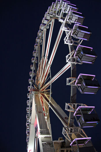 Amusement Park Amusement Park Ride Arts Culture And Entertainment Ferris Wheel Night Low Angle View Fairground Sky No People Illuminated Metal Spinning Clear Sky Outdoors Nature Architecture Motion Ride Carnival Speed Excitement