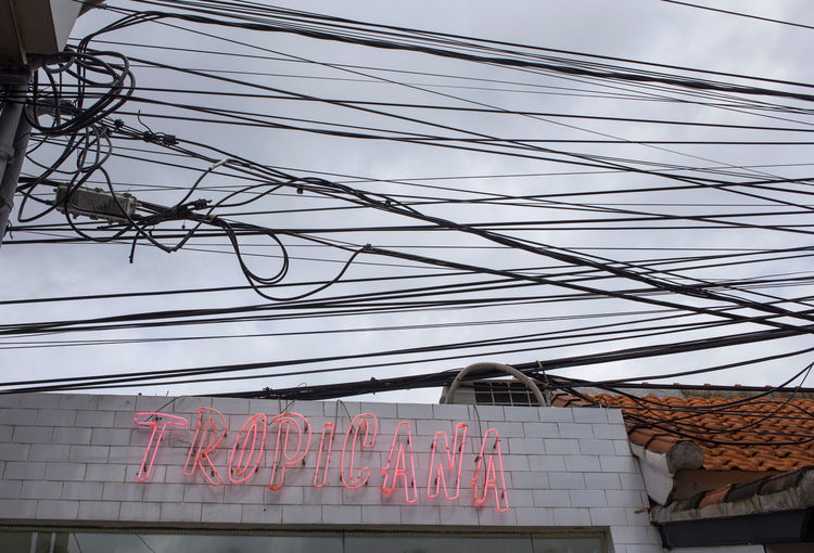 Built Structure Cable Communication Day Electricity  Electricity Pylon Horizontal Neon Lights No People Outdoors Power Line  Tropicana