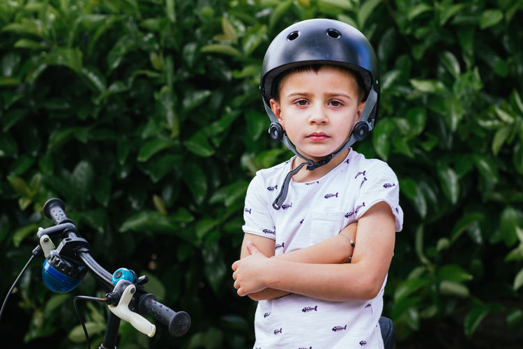 Portrait of cute boy in bicycle