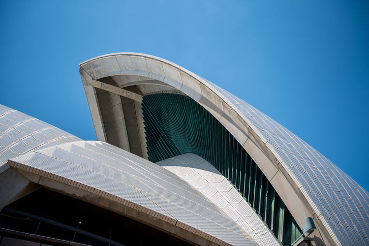Sydney Sydney, Australia Sydney Opera House Harbour Australia Travel Travel Destinations Built Structure Architecture Building Exterior Sky Blue Low Angle View Clear Sky Modern Building No People Day Nature City Sunlight Outdoors Religion Copy Space Belief Office Building Exterior Skyscraper