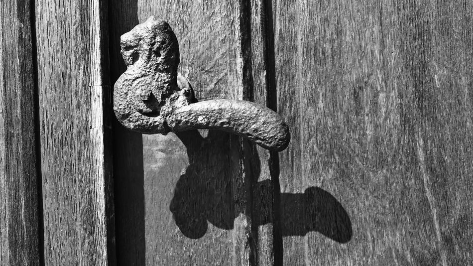 Black And White Photography Close-up Day Door Door Handle Door Knocker Doorknob Doorknob Old Entrance Focus On Foreground Knob Latch Metal No People Old Outdoors Protection Rusty Safety Security Textured  Weathered Wood Wood - Material Wooden Post