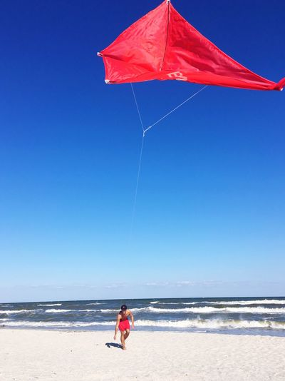 beach fun Kite EyeEm Nature Lover EyeEm Best Shots Windy Sea Beach Water Sky Land Childhood Nature Blue Horizon Over Water Clear Sky One Person Sunny Sunlight Sand Men Outdoors