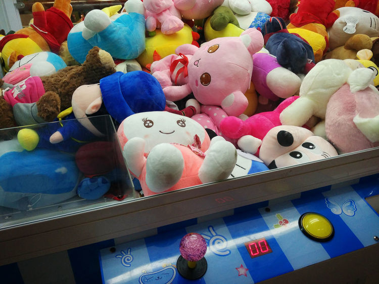 Japanese Claw Machine Anime Arcade Games Buttons Choice Claw Machine Close-up Coin Day Doll Fun Game Indoors  Japanese  Joystick Landscape Large Group Of Objects Machine Multi Colored No People Play Shelf Skill  Soft Toys Variation