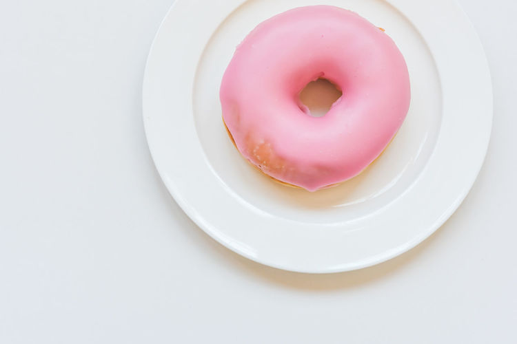 High angle view of pink cake on plate