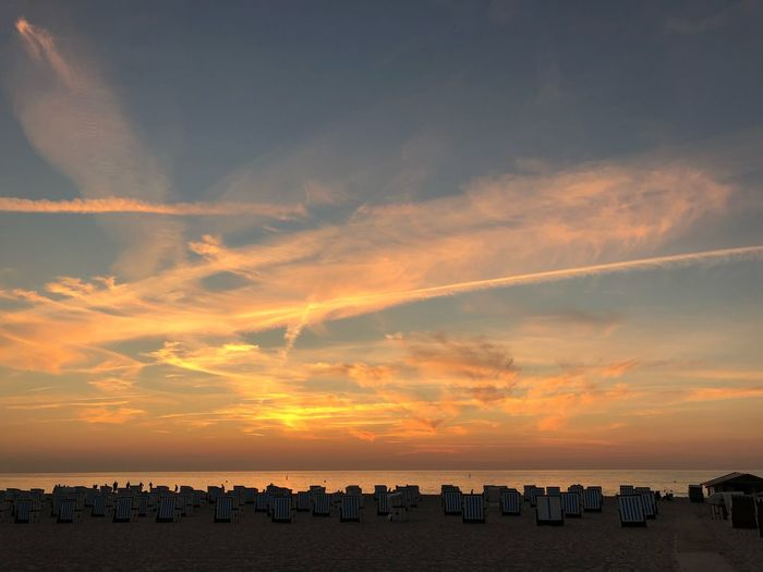 Beachphotography Sunbeam IPhone X IPhone X Photography Warnemünde Baltic Sea Summer Summertime Sky Sunset Sea Cloud - Sky Water Beauty In Nature Scenics - Nature Beach Orange Color Land Large Group Of People Nature Tranquility Group Of People Tranquil Scene Crowd Horizon Over Water Real People Horizon Outdoors
