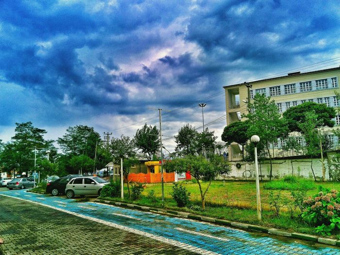 Transportation Mode Of Transport Tree Land Vehicle Built Structure Railroad Track Architecture Sky Building Exterior On The Move Cloud - Sky Travel Cloudy Stationary Blue Day Green Color Outdoors Journey City Life HDR Photographer Mobilephotography Photography Eye4photography