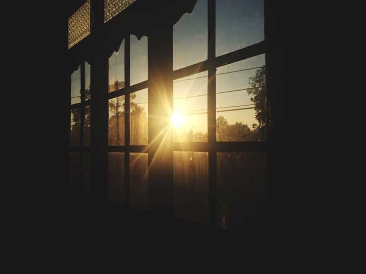 Sunset view👍👌😜 Sunlight Lens Flare Window Sun Sunbeam Indoors  Sunset Built Structure Streaming No People Architecture Day Nature Sky Domestic Room Close-up