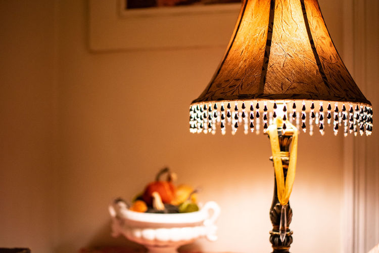 Lighting Equipment Indoors  No People Focus On Foreground Electric Lamp Illuminated Lamp Shade  Home Interior Close-up Table Domestic Room Electricity  Food And Drink Wall - Building Feature Electric Light Still Life Light Food Art And Craft Decoration