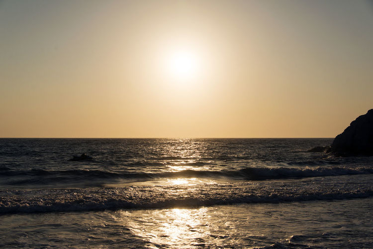 A horizon view of a seascape in sunset in Mediterranean in summer time Ocean View Reflection Seascape Photography Shiny Tranquility Travel Wave Beauty In Nature Beauty In Nature Horizon Over Water Nature Ocean Outdoors Paradise Power In Nature Rippled Scenics Scenics - Nature Sea Seascape Splash Sunset Water