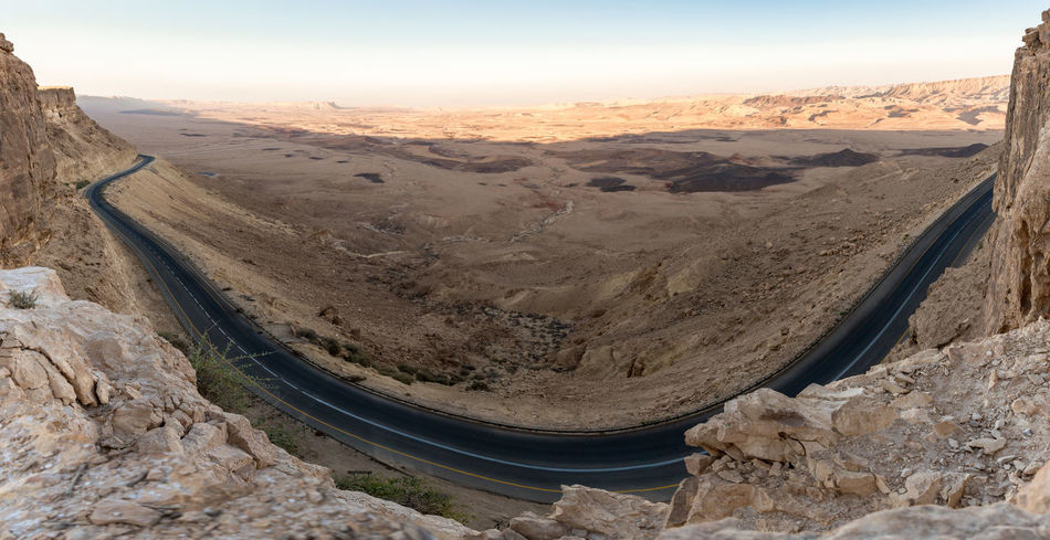 Panoramic view from the mountain cliff at sunset on the Judean desert in Israel Light Natural Rock Scenic Skyline Sunny View Adventure Background Beauty In Nature Environment Israel Journey Judean Desert Landscape Mountain Mountain Cliff Park Scenics - Nature Sky Sun Sunset Tranquil Scene Tranquility Travel Destinations