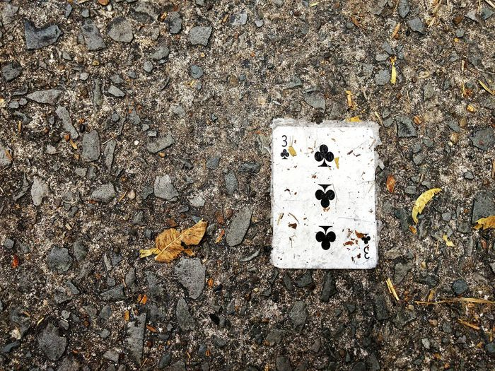 Three of Clubs playing card on grungy concrete floor. Top View Three Clubs Playing Card Grungy Concrete Floor Poker Cards Number 3 High Angle View Outdoors Day No People Art Is Everywhere Backgrounds The Still Life Photographer - 2018 EyeEm Awards