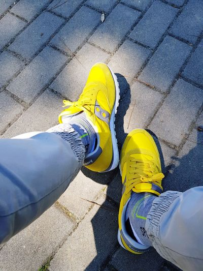 Gialle Le Mie Snikers Low Section Men Yellow Standing Shadow Human Leg Shoe High Angle View Sunlight Human Foot