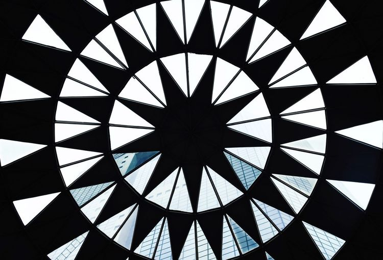 Building in a symmetry Clock Face Full Frame Pattern Triangle Shape Close-up Sky Geometric Shape Hexagon Triangle Skylight Seamless Pattern Directly Below Pyramid Architectural Feature Architectural Design Architectural Detail Circular Ceiling