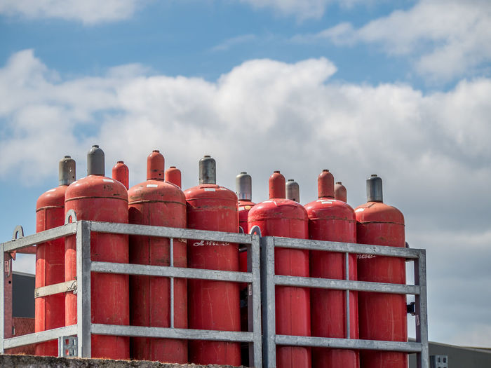 Gas bottles Red Cloud - Sky Factory Industry Sky Day No People Built Structure Oil Industry Architecture Outdoors Pipe - Tube Metal Fuel And Power Generation Equipment Side By Side Business Order Low Angle View Gas Station Gas Bottles Industrial Equipment Industry