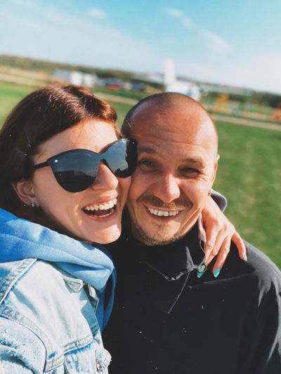 Portrait of smiling man and woman outdoors