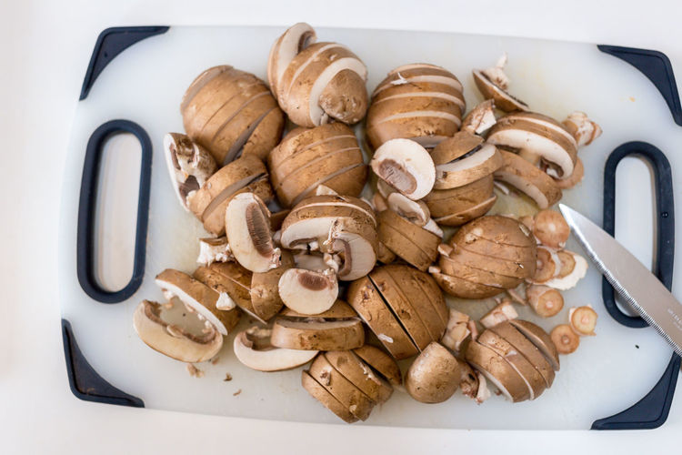 Cooking Cooking At Home Brown Mushrooms Chestnut Mushroom Chopping Board Close-up Cutting Board Edible Mushroom Food Food And Drink Freshness Fungus Healthy Healthy Eating High Angle View Indoors  Kitchen Mushroom No People Preparing Food Sliced Sliced Mushrooms Still Life Vegetable