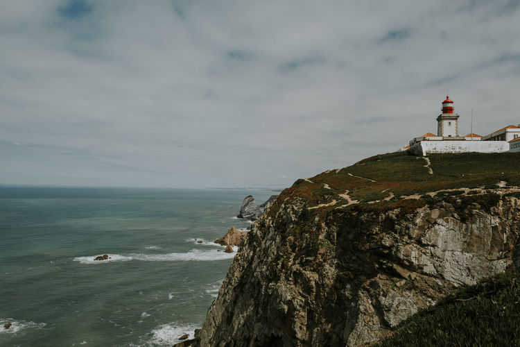 Lighthouse Sintra Travel Built Structure Coast Guidance Horizon Over Water Journey Lighthouse Mountain Nature No People Outdoors Rock Scenics - Nature Sea Sky Tower Travel Destinations Windy