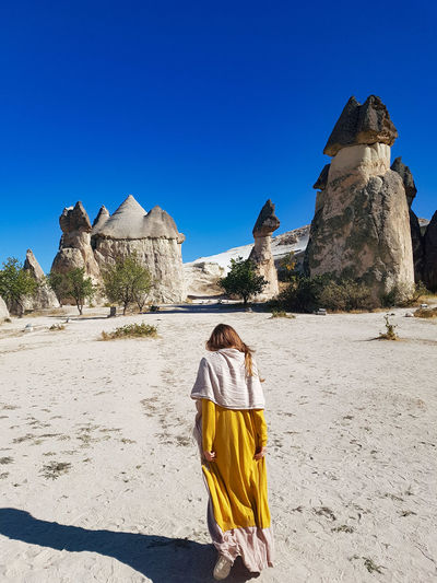 Cappadocia Summer Spring Rock Stone Turkey Cappadocia Clear Sky Desert Pyramid Full Length Sand Sand Dune Portrait Young Women Blue Arid Climate Archaeology Old Ruin