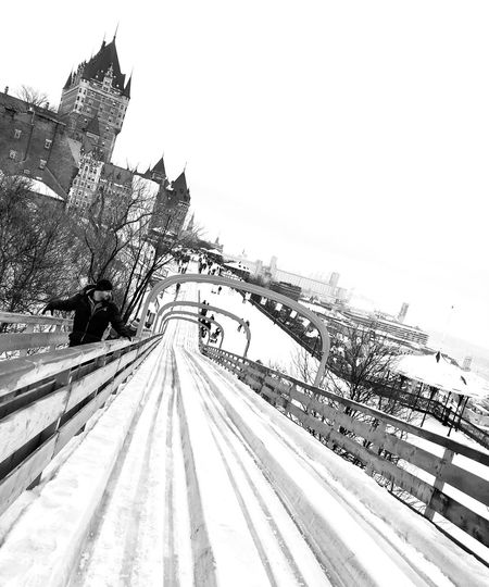 Chateau Frontenac Hotel Sky Clear Sky Nature Day No People Copy Space Architecture Outdoors Building Exterior Transportation Winter Built Structure Scenics - Nature Railroad Track Tranquil Scene Road The Way Forward Beauty In Nature Snow Plant