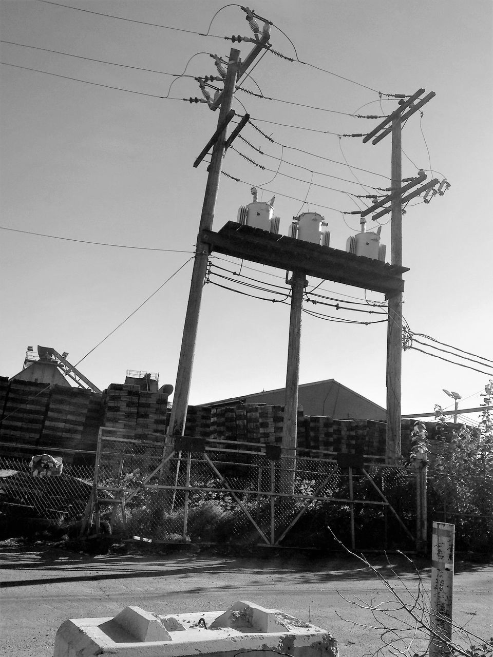 cable, connection, power line, electricity pylon, electricity, power supply, built structure, architecture, sky, technology, outdoors, no people, day, low angle view, building exterior, telephone line