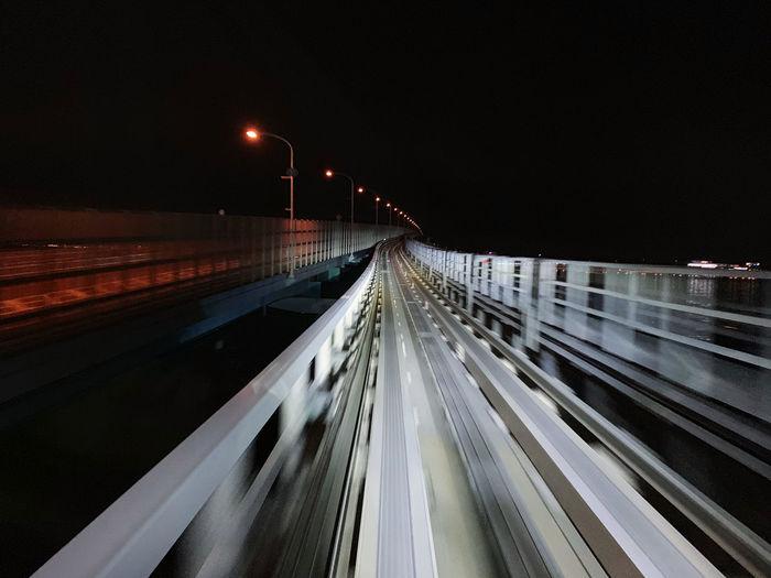 Light trails on road at dark night.