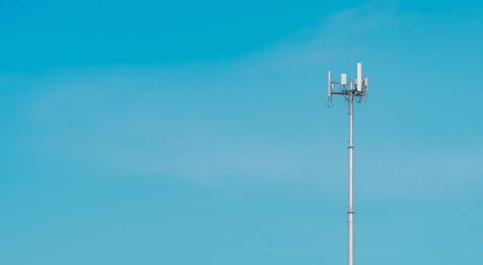 Telecommunication tower with clear blue sky background. the antenna on blue sky. radio